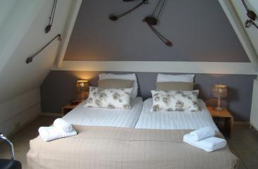 1 van de 25 verschillende kamers in Hotel de Tabaksplant